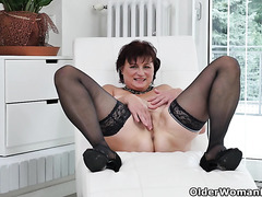 Euro milf Danja strips off and dildo fucks herself