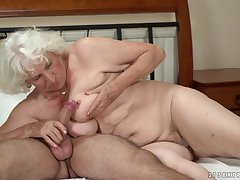 Horny granny gets her pussy serviced unconnected with a young cadger