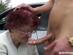 Sjort haired redhead granny gives a sloppy blowjob POV in a car