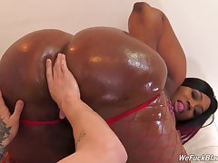 Thick ebony goes wild above a black fucker