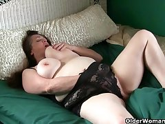 Large-Breasted granny takes usage of her throbbing clit