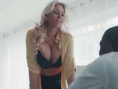 Mega busty secretary Katie Morgan gives a blowjob together with goes black for the first age