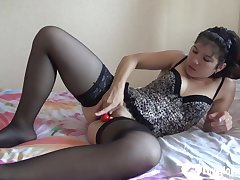 mommy wearing glowering stockings masturbates with a dildo